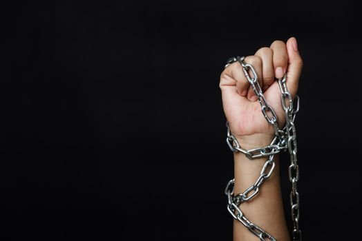 Woman chained on hand