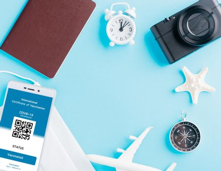 Model airplane, passport and immunity pass are arranged application on smartphone