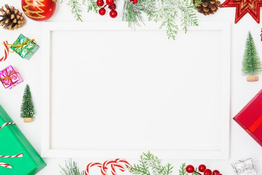 Christmas composition decorations, fir tree branches with Photo square frame on white background