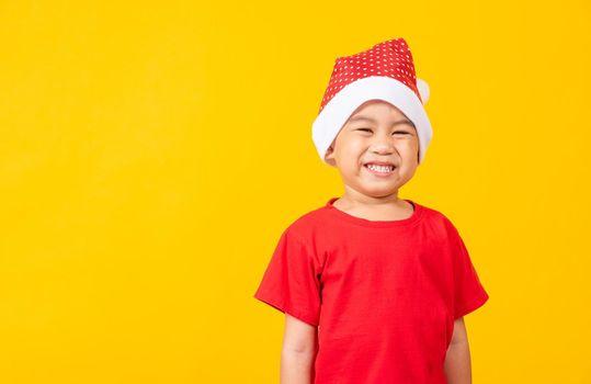 Kid dressed in red Santa Claus hat