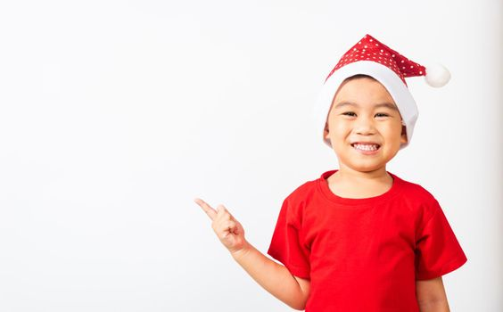 Kids dressed in red Santa Claus hat point finger