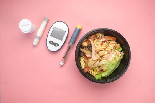 diabetic measurement tools and insulin pen and healthy food on pink