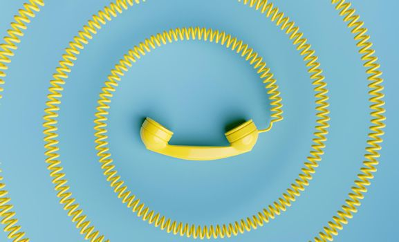 telephone handset with coiled cord towards the center of the image