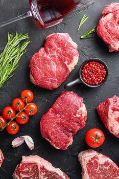 Two rump beef steak cuts, with herbs, seasoning on black table, top view.