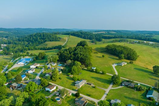 An aerial establishing view of the small Bentleyville town villages on the hills of Pennsylvania USA