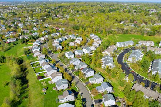 Small american town district with houses and roads on aerial view