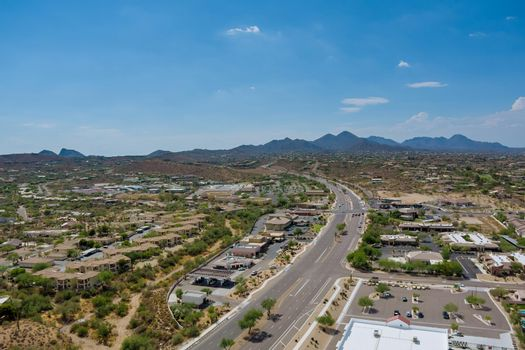 Overlooking view of a small town a Fountain Hills in the N Beeline Hwy US 87 interchanges highways of in Arizona USA