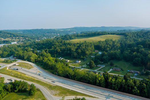 Panoramic view of Dwight D. Eisenhower highway 70 road near small Bentleyville town hills the farm meadow in Pennsylvania, US