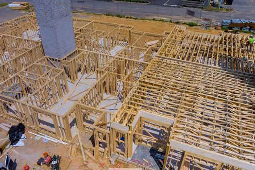 Wood building frame structure on a new development