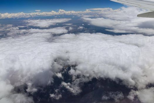 Wing aircraft in altitude during flying above the clouds