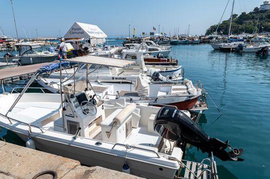 motorboats on the pier of porto santo stefano
