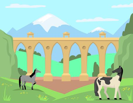 Horses grazing in background of old bridge and landscape