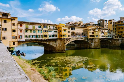 Ponte Vecchio bridge over the Arno River in Florence Italiy, colourful bridge over the river in Florence