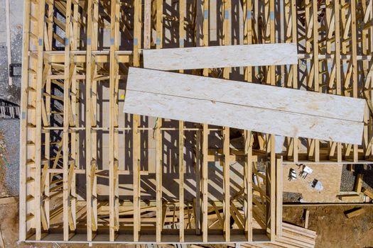 Truss, joist, beam new house under construction exterior framing timber framing