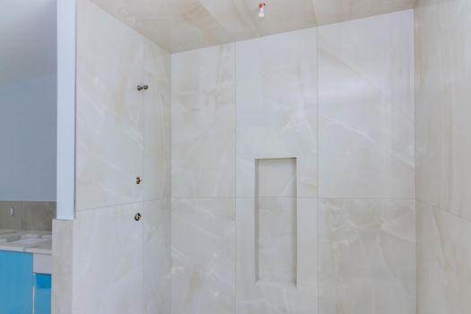 Designer renovation construction bathroom with master bathroom walls tiled shower