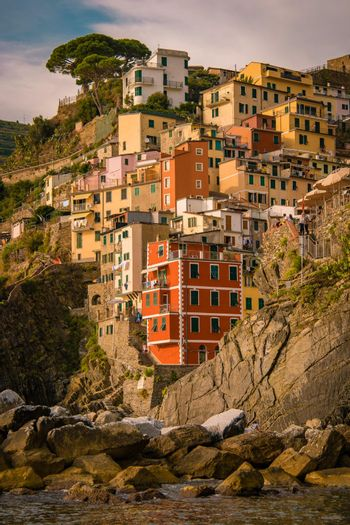 View of Riomaggiore Cinque Terre sequence of hill cities. Wonderful view of Liguria, Italy, Europe. seascape of the Mediterranean sea. Traveling concept background. Riomaggiore Cique Terre Italy