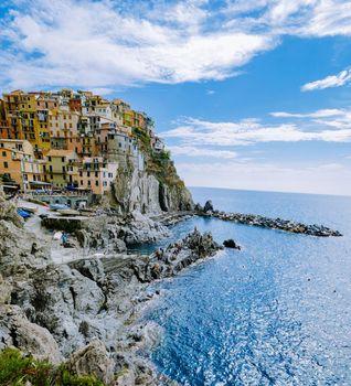 Manarola village, Cinque Terre park Italy during a summer day, vacation Italy colorful coast Manarola Cinque Terre Italy.