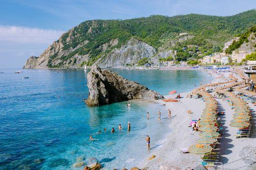 Cinque Terre Italy Monterosso September 2018, Chairs and umbrellas fill the Spiaggia di Fegina beach, the wide sandy beach village of Monterosso Italy, part of the Cinque Terre Italy