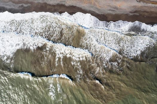 Aerial view of waves and beach at morning