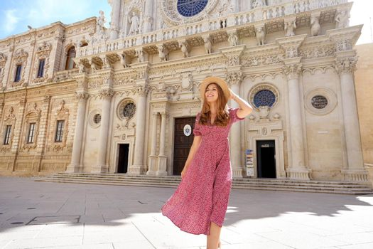Attractive woman walking in the baroque city of Lecce, Italy