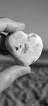 Stone heart in hand. Desktop for phone screensaver
