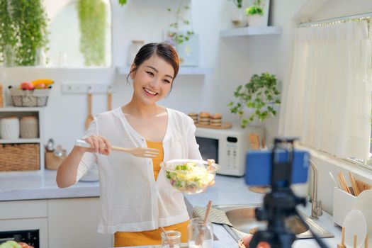 Food blogger recording video tutorial at home