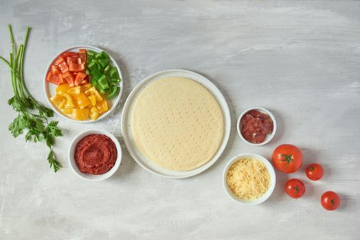 Preparing individual pizzas from pizza bar