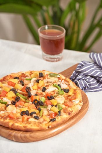 Appetizing homemade pizza on a white background