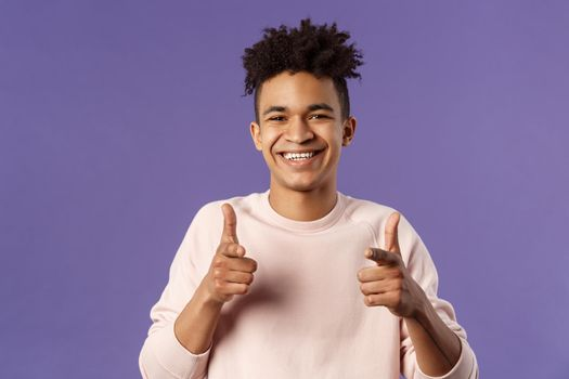 You got it. Close-up portrait of smiling cute young hispanic man saying good luck, pointing fingers at camera with pleased cute grin, encourage person apply for job, headhunter picking new candidates