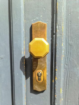 Close up of a metal lock at a closed Door