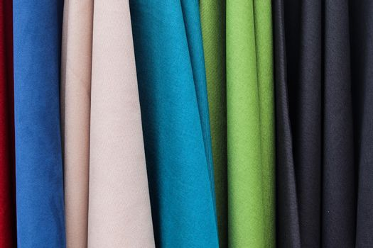 Detailed close up view on samples of cloth and fabrics in different colors found at a fabrics market
