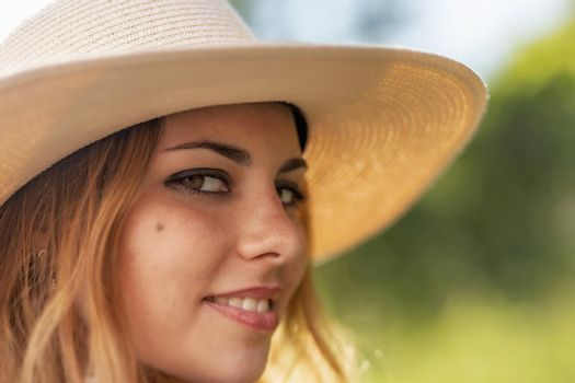 Closeup view  of face of the attractive young woman.