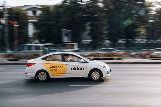 Ukraine, Kyiv - 16 July 2021: White Hyundai Accent Taxi Uklon car moving on the street. Editorial