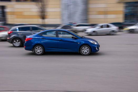 Ukraine, Kyiv - 26 April 2021: Blue Hyundai Accent car moving on the street. Editorial