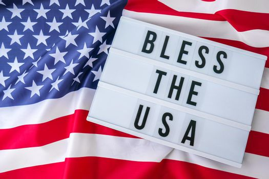 American flag. Lightbox with text BLESS THE USA Flag of the united states of America. July 4th Independence Day. USA patriotism national holiday. Usa proud.
