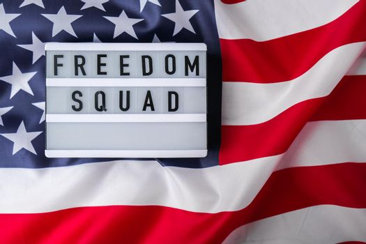 American flag. Lightbox with text FREEDOM SQUAD Flag of the united states of America. July 4th Independence Day. USA patriotism national holiday. Usa proud.