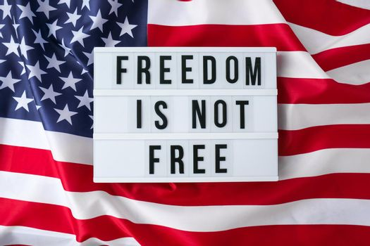 American flag. Lightbox with text FREEDOM IS NOT FREE Flag of the united states of America. July 4th Independence Day. USA patriotism national holiday. Usa proud.
