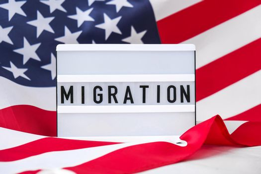 American flag. Lightbox with text MIGRATION Flag of the united states of America. July 4th Independence Day. USA patriotism national holiday. Usa proud.