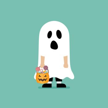 Boy with pumpkin basket dressed in ghost costume