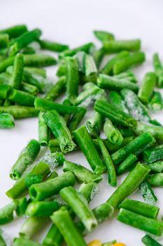 Frozen vegetables food background of yellow corn, green beans. Harvest Food preservation for winter. Veganism, vegetarian healthy eating.