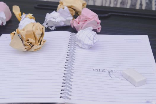 Erasing Mistake on notepad. Learning, wrong, blooper, regret sayings background. Fault, defect, careless, lesson correction and reconciliation thought concept for love friendship relationship.