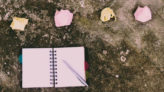 Notebook pen and crumpled paper on rustic floor. Mistake Learning, wrong, blooper, error, regret sayings background. Feelings, apology, message, love, in relationship friendship concept. Flat Lay