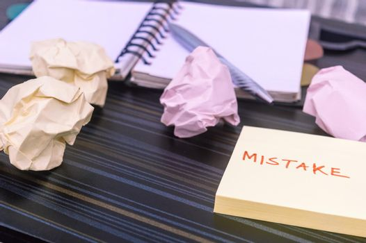 Mistake written on sticky notes. Learning, wrong, blooper, error message, regret sayings background. Fault, defect, careless, lesson correction and reconciliation concept for business finance industry