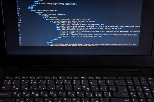 Close up css HTML code on monitor screen with black background