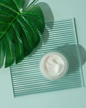 Cosmetic cream aesthetic layer topview, copyspace