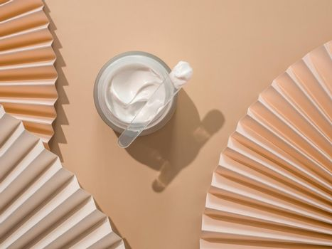 Aesthetic layer with cosmetic cream and fans