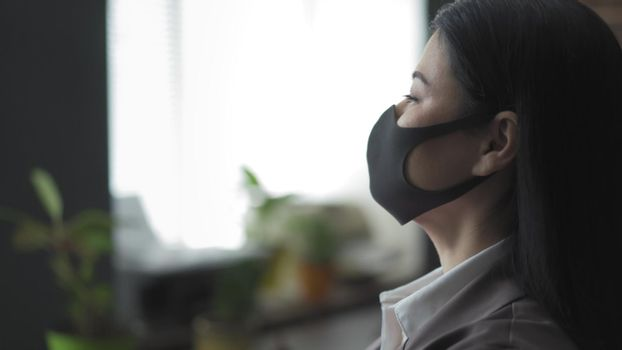 Businesswoman In Protection Mask Looks At Side