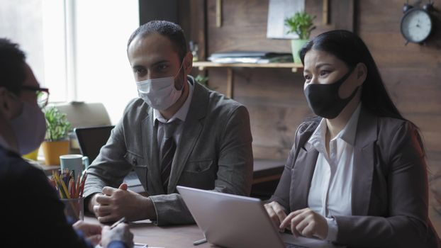 Diverse Group Of People Works In Office During Epidemic
