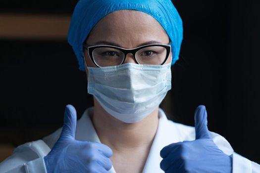 Medic In Protective Uniform ShowingThumbs Up Gesture
