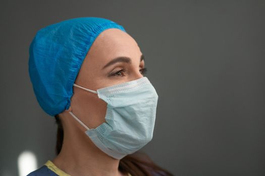 Portrait Of Young Female Medic In Protective Mask